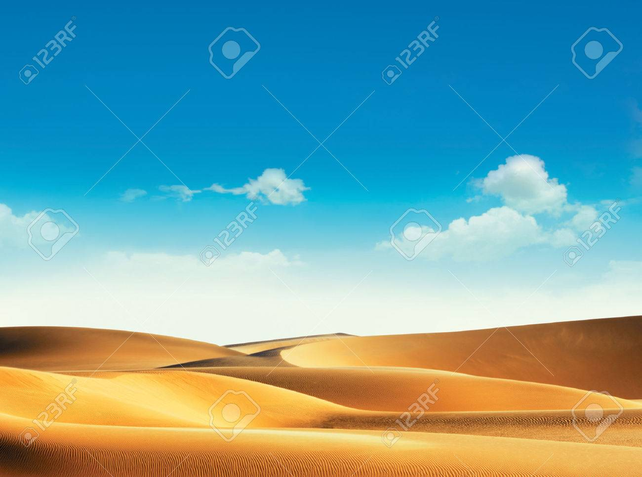 Desert and blue sky with clouds - 34256841