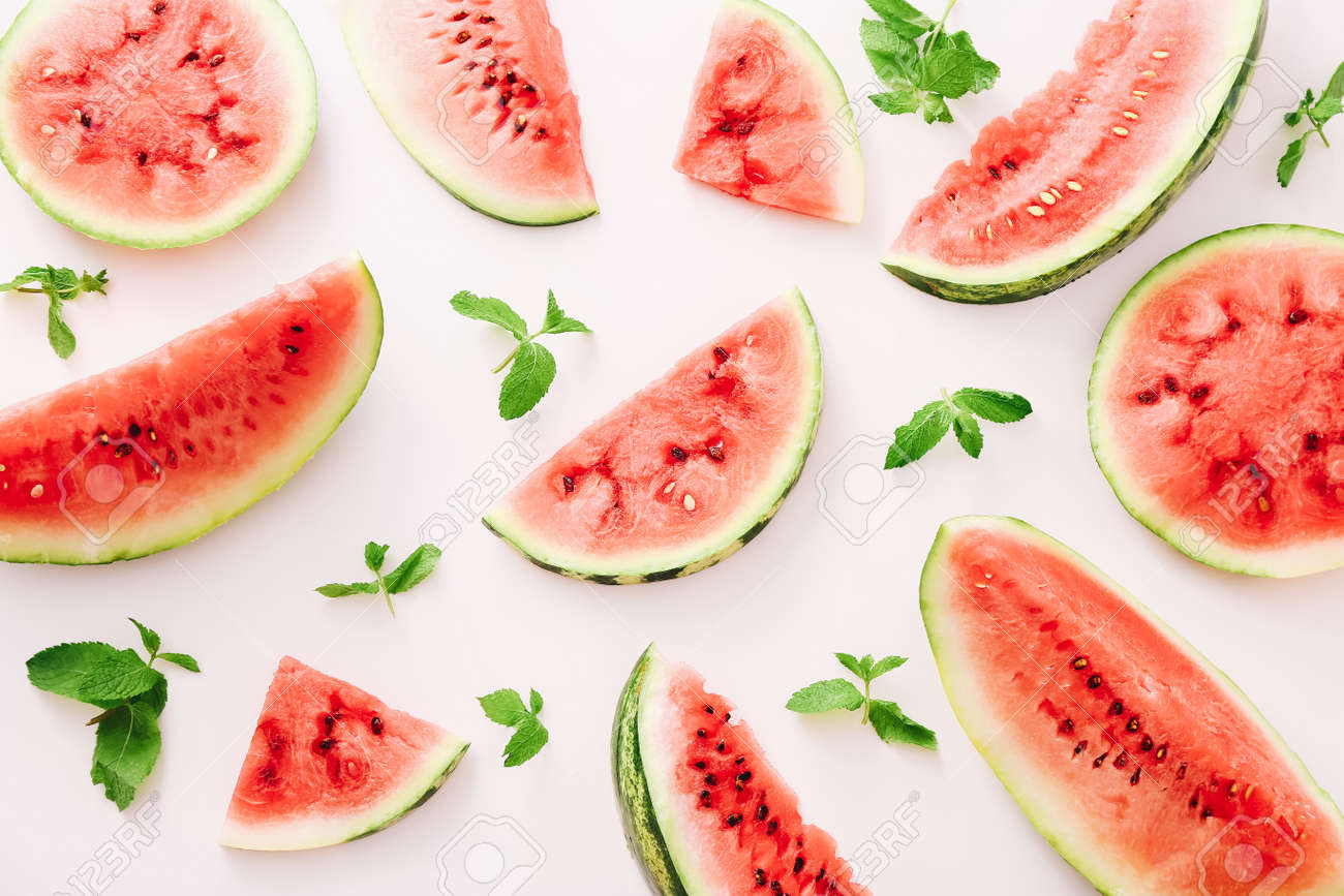 Watermelon pieces pattern on white background with mint leaves. Top view - 156160553