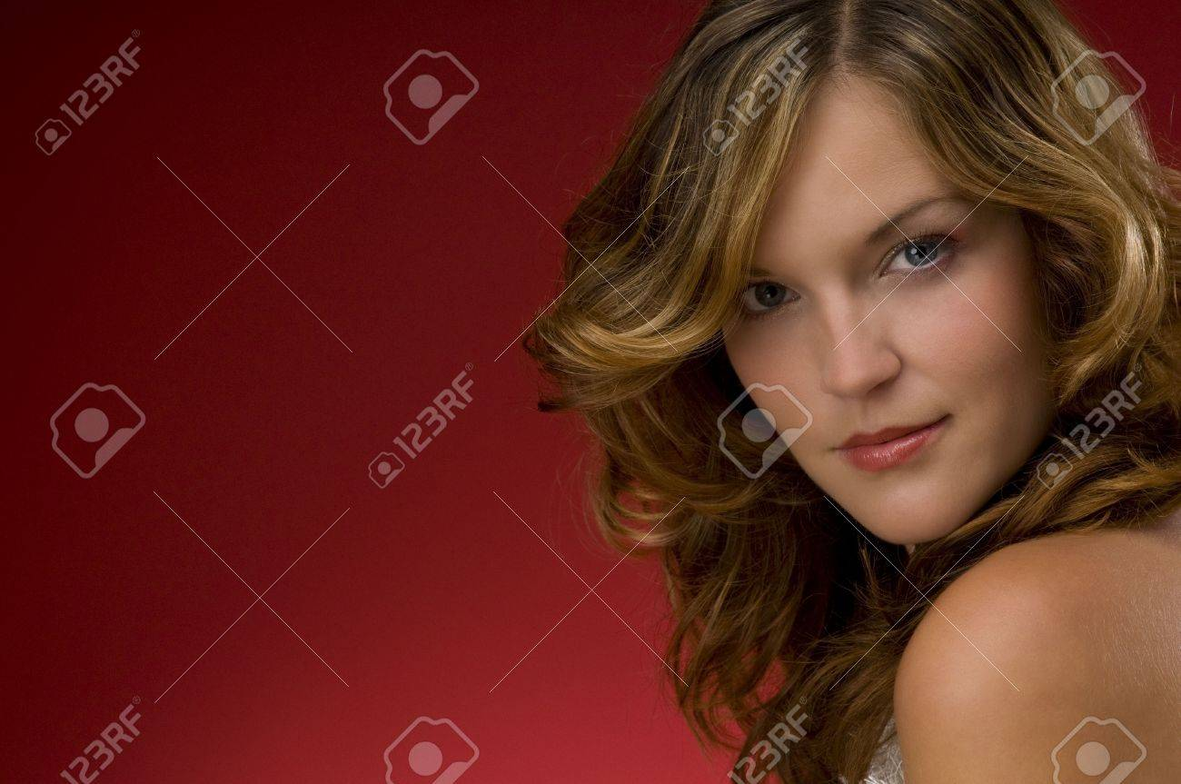Young fashion lady on Christmas red background with naked shoulder Stock Photo - 3794934