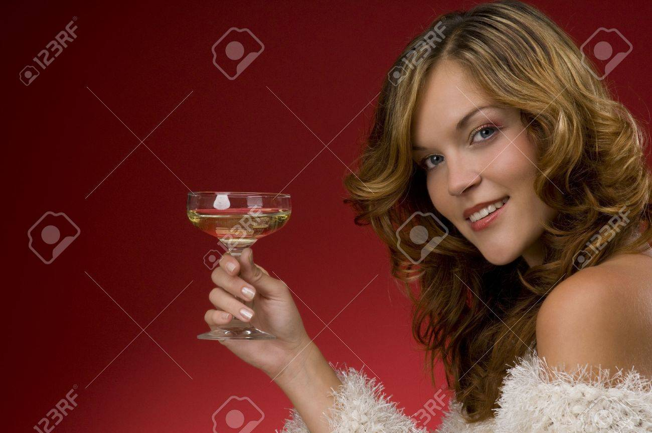Beautiful lady toasting with champagne on red background Stock Photo - 3794933