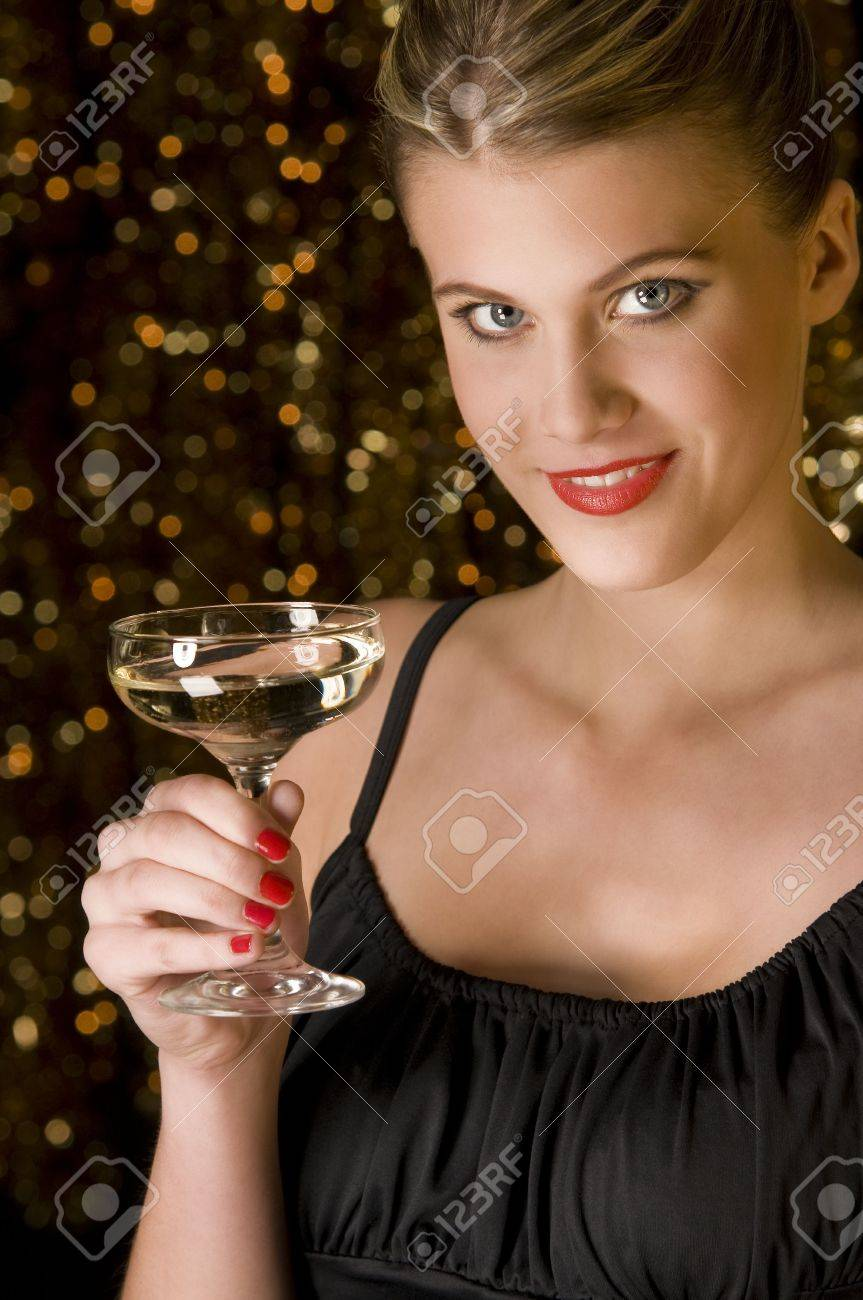Sexy girl toasting with glass of champagne in front of out of focus Christmas lights Stock Photo - 3837004