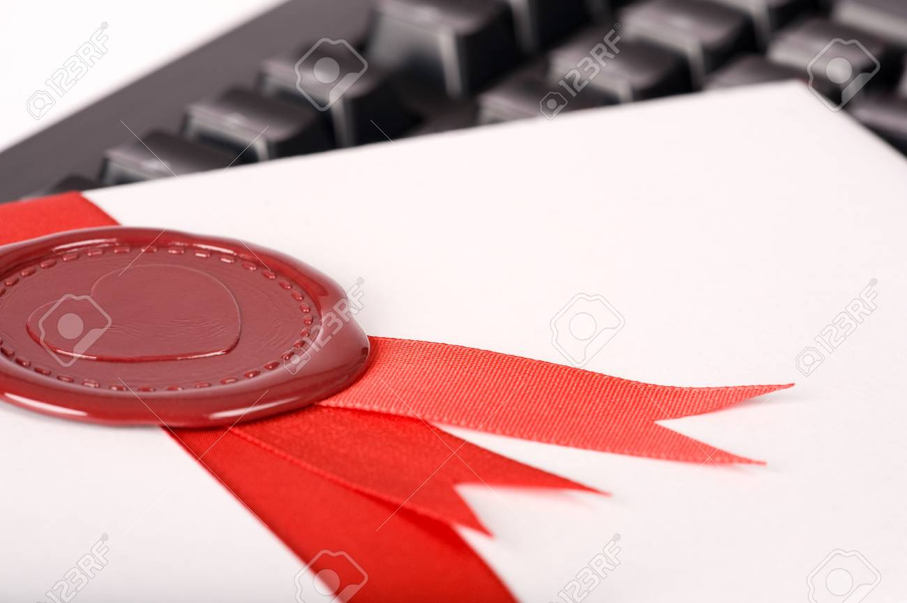 Seal with heart symbol on love-letter lying on black keyboard Stock Photo - 4119097