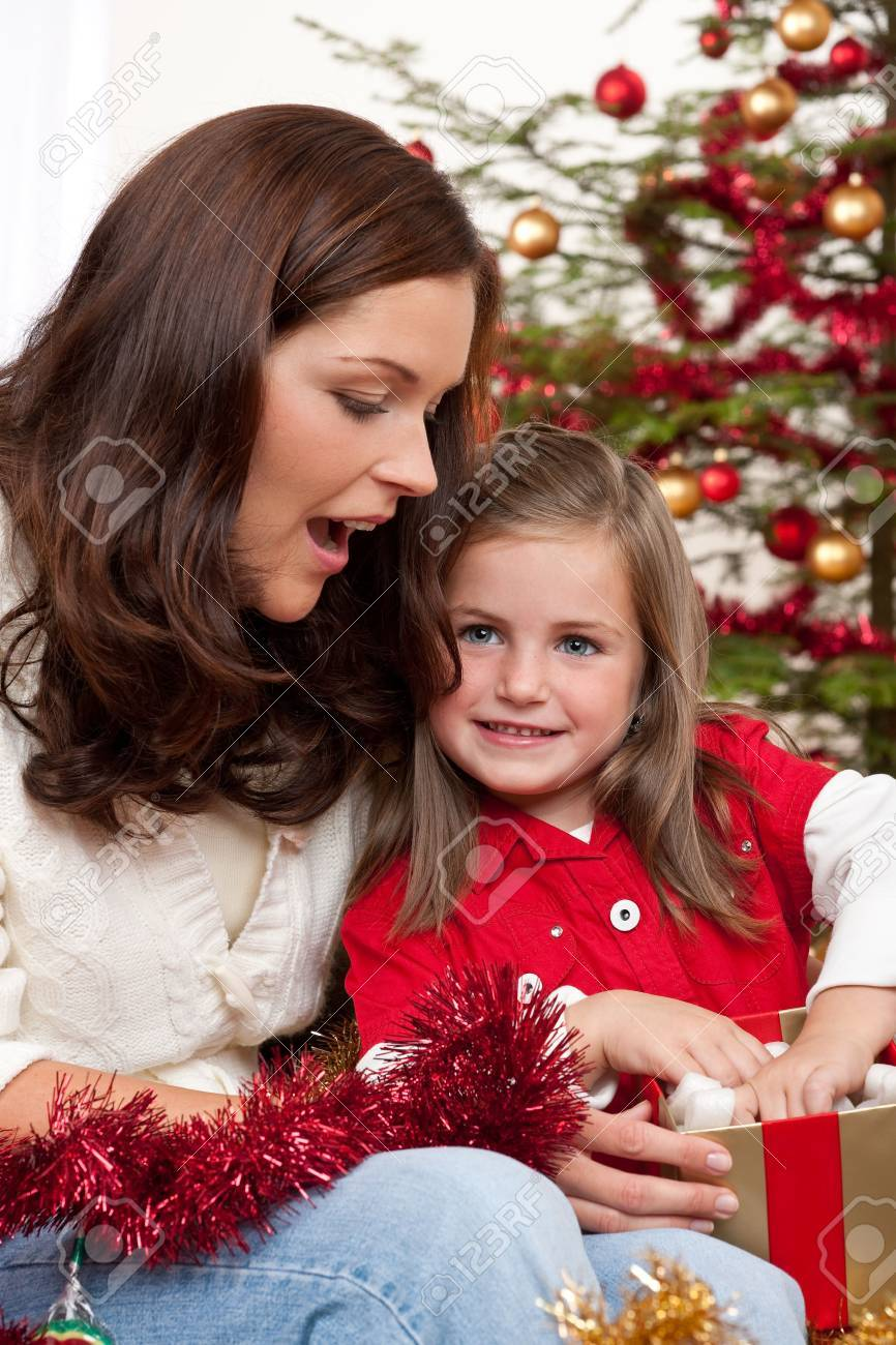 Mother with child opening present on Christmas Stock Photo - 5714602