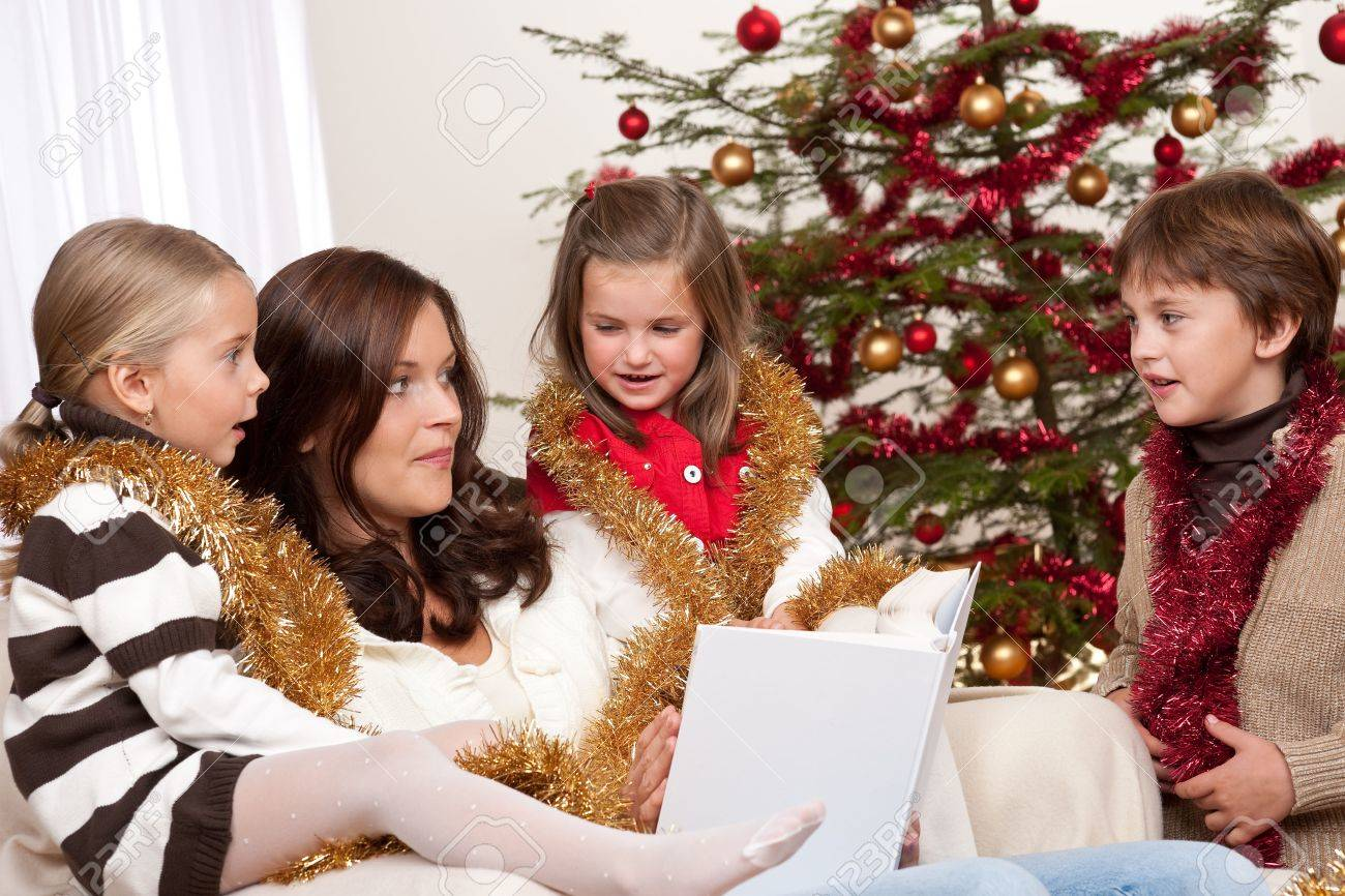 Happy family: mother with three children on Christmas Stock Photo - 5714612