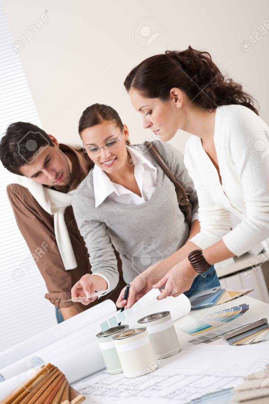 Interior Designers With Clients female interior designer with two clients at office choosing