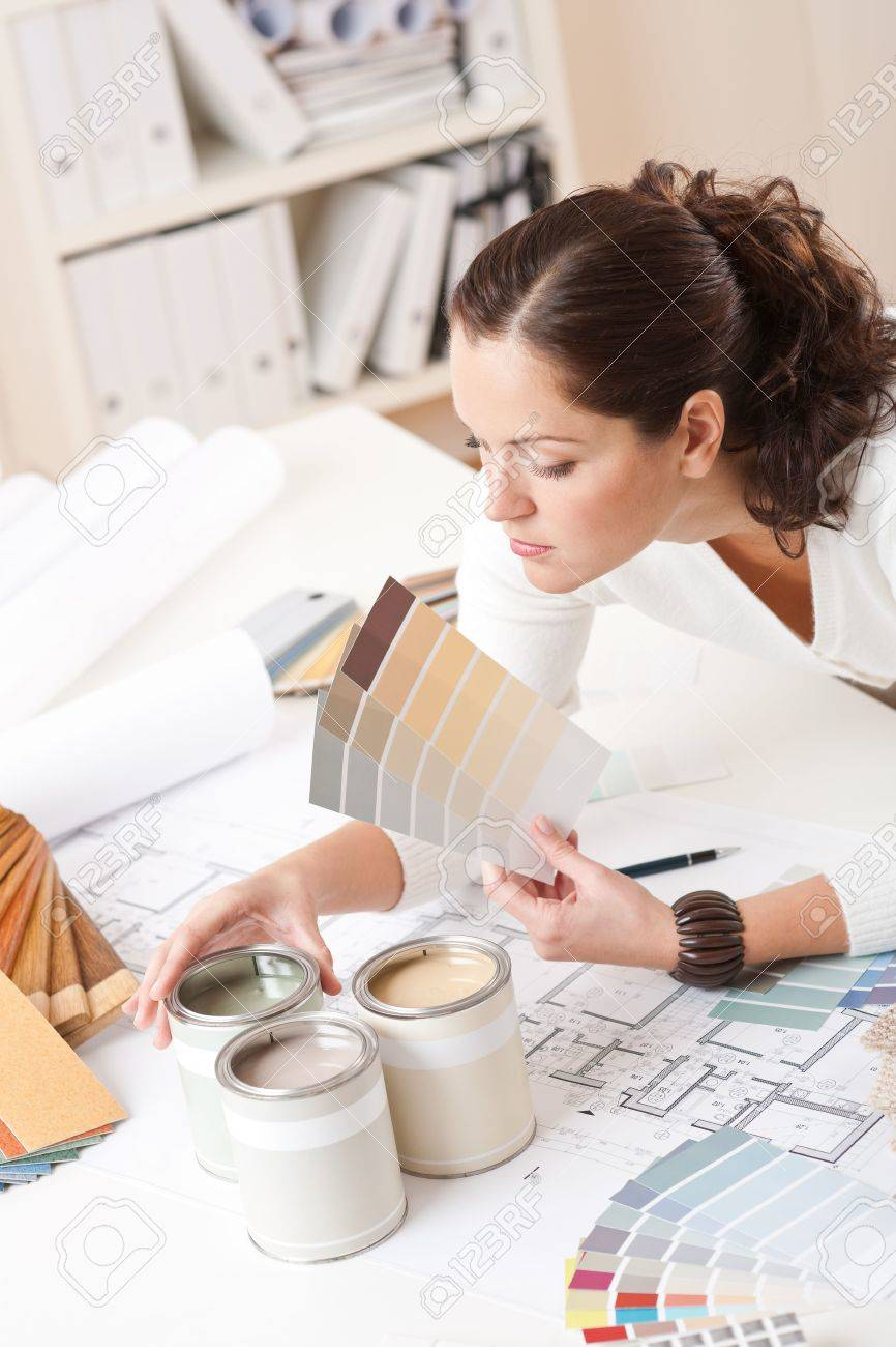Young Female Interior Designer t Office With Paint nd olor ... - ^