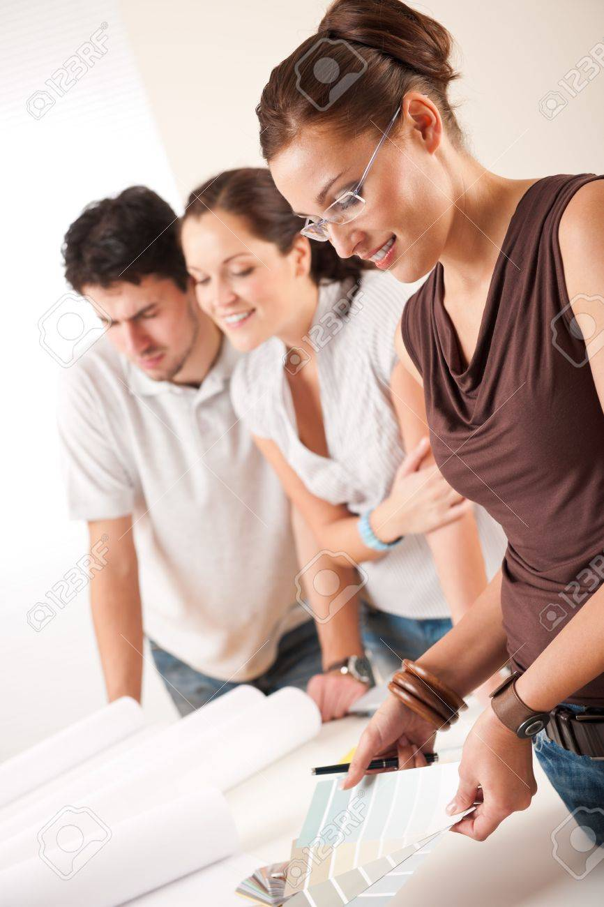 Female interior designer with two clients at office choosing colors Stock Photo - 5996514