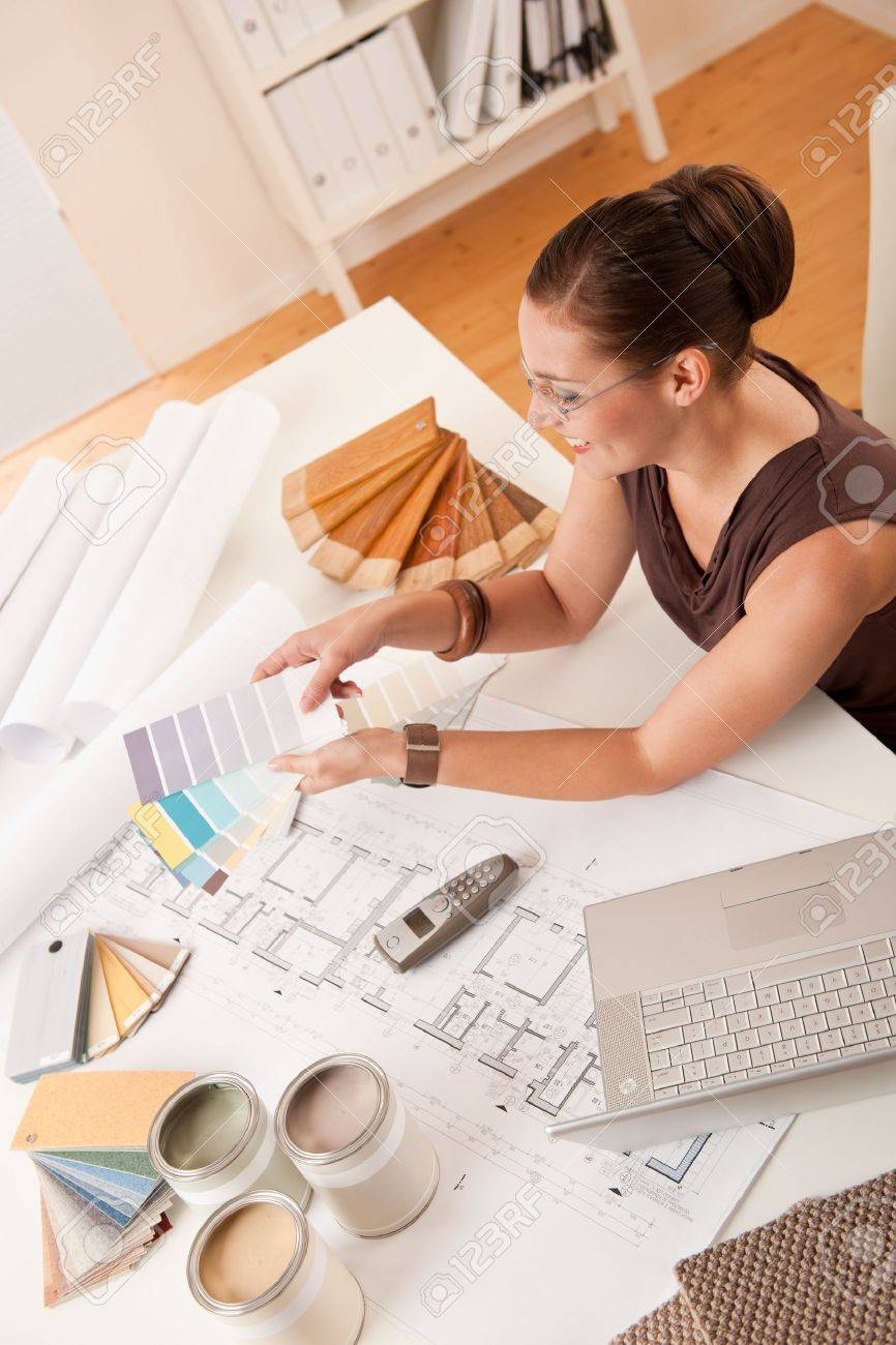 Female Interior Designer With olor Swatches nd Laptop t Office ... - ^