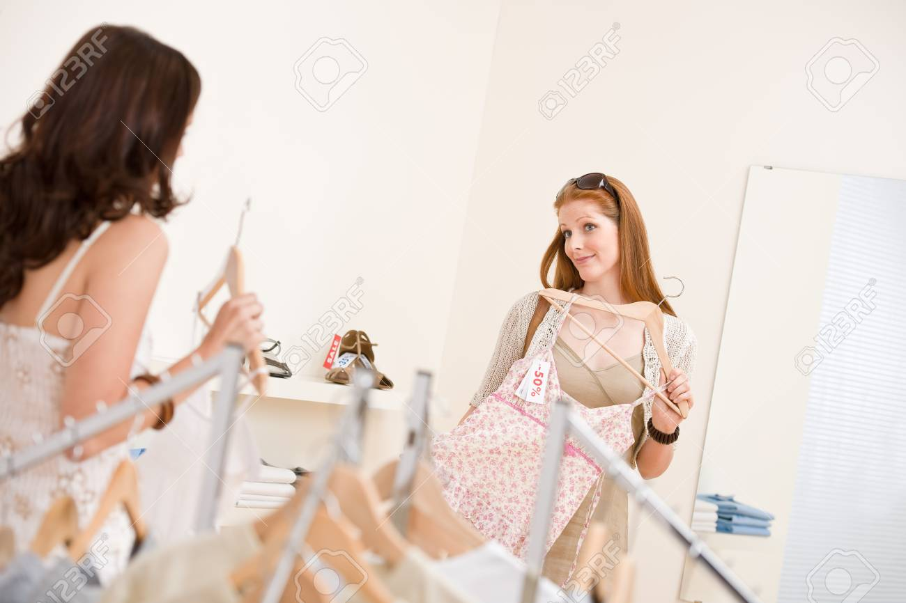 Fashion shopping -  Two happy young woman choose clothes in shop Stock Photo - 7169555
