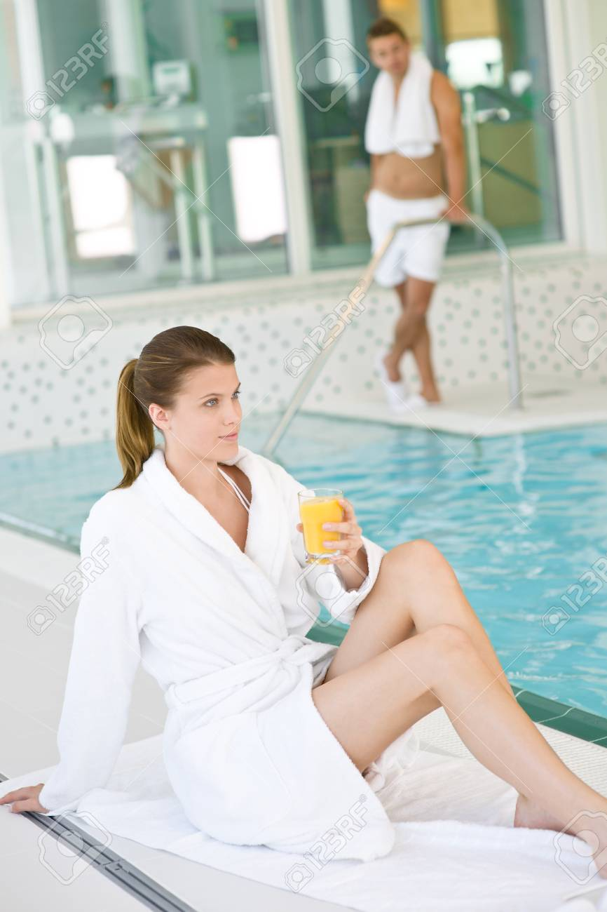 Swimming pool - young woman relax on poolside, hold orange juice Stock Photo - 7355808