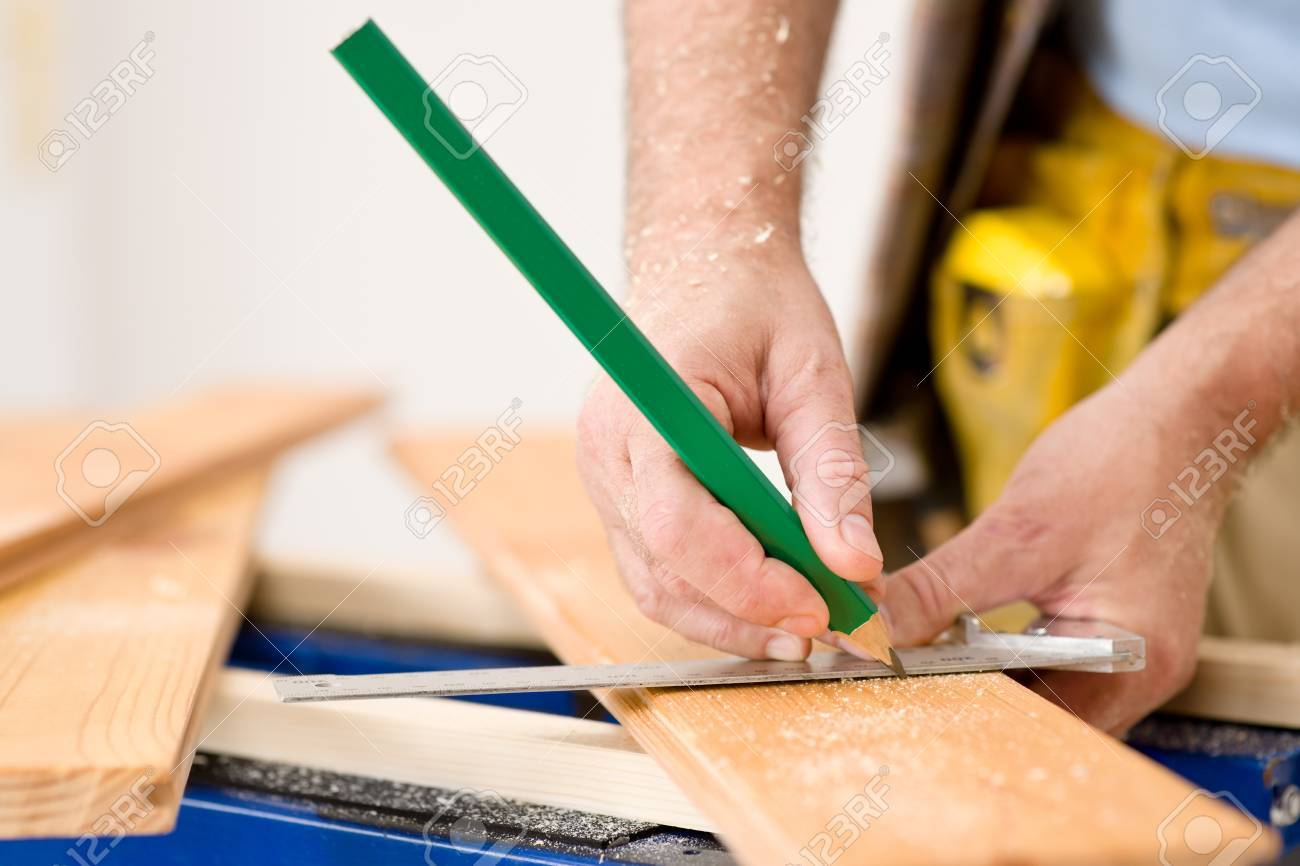 Home improvement - close-up of handyman measure wooden floor Stock Photo - 8546340