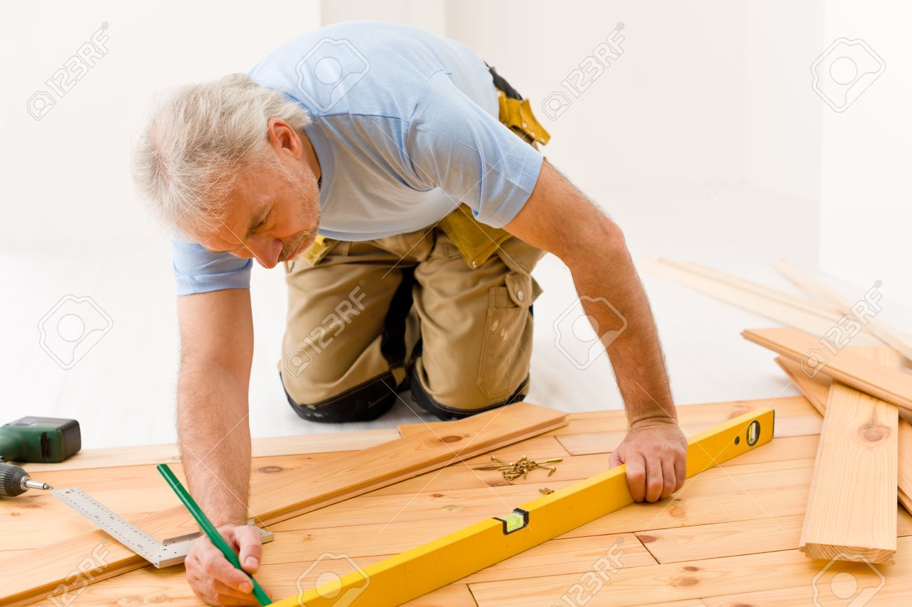 Home improvement - handyman installing wooden floor home Stock Photo - 8641932