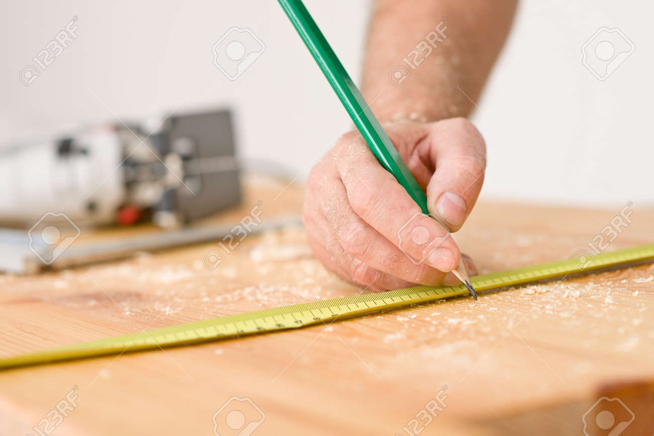 Home improvement - close-up of measuring wood in workshop Stock Photo - 8641941