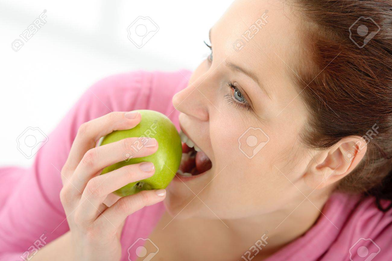 Fitness woman eat apple sportive outfit in gym Stock Photo - 9330935