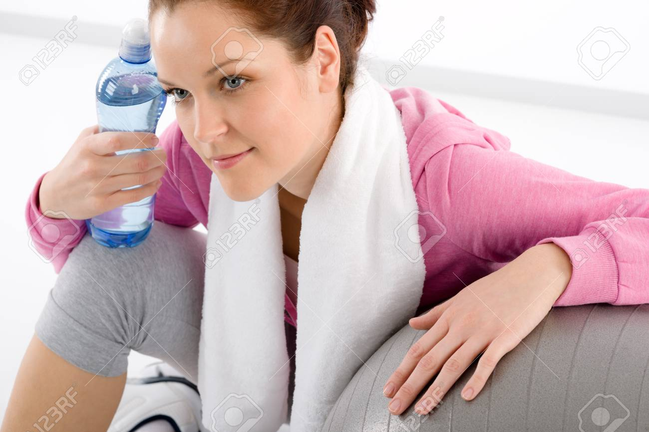 Fitness woman relax water bottle ball sportive outfit Stock Photo - 9331779