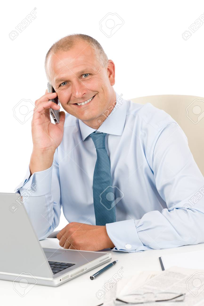 Portrait of successful smiling businessman sitting behind table Stock Photo - 9682602