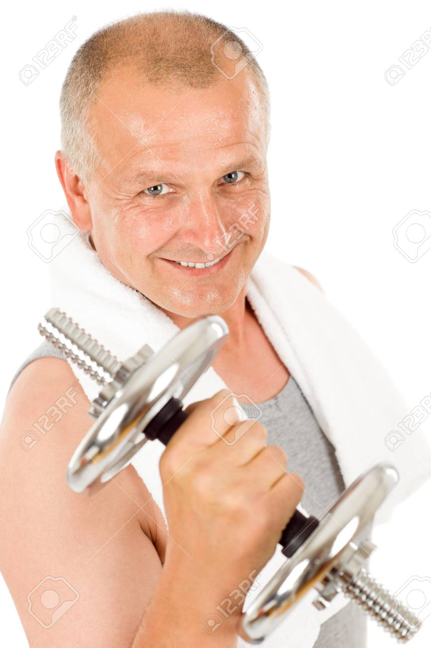 Portrait of happy fit mature man working out with dumbbells Stock Photo - 9682613