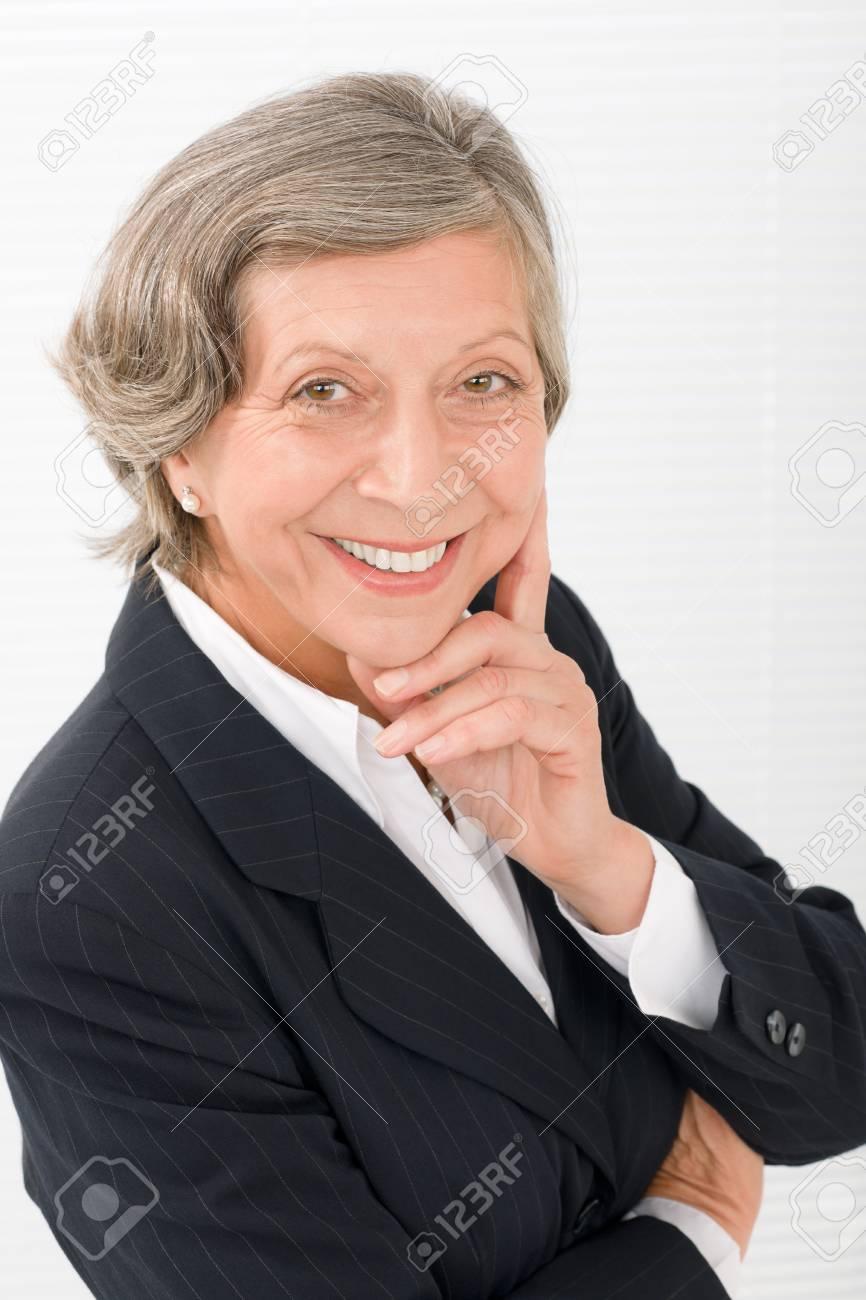 Successful senior businesswoman professional portrait watch camera Stock Photo - 11109693
