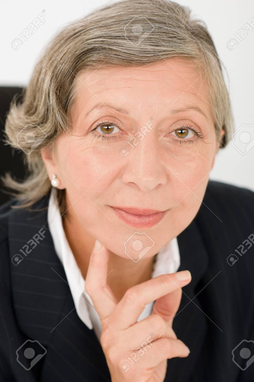 Successful senior businesswoman professional portrait watch camera Stock Photo - 11109722