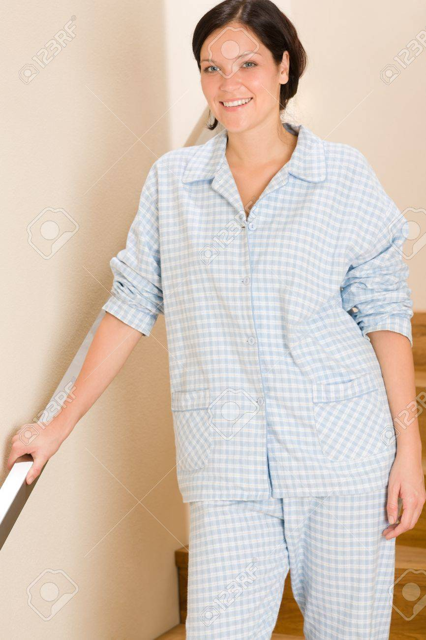 Happy morning young woman in pajamas standing on the stairs Stock Photo - 11476368