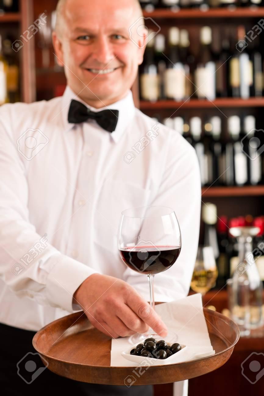 Wine bar waiter mature serving on tray glass olives restaurant Stock Photo - 11851134