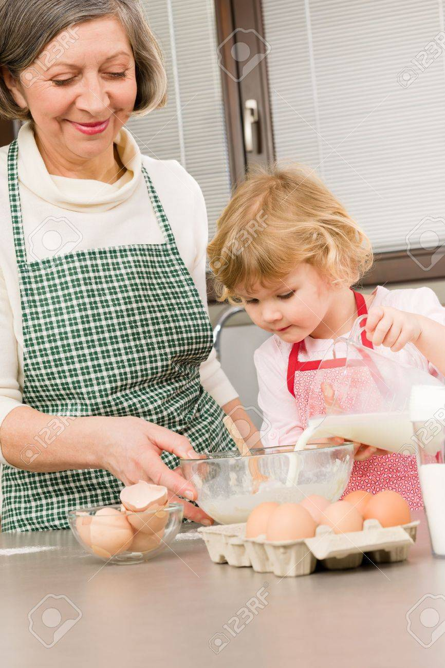 Grandmother and granddaughter baking cookies prepare dough Stock Photo - 12758286