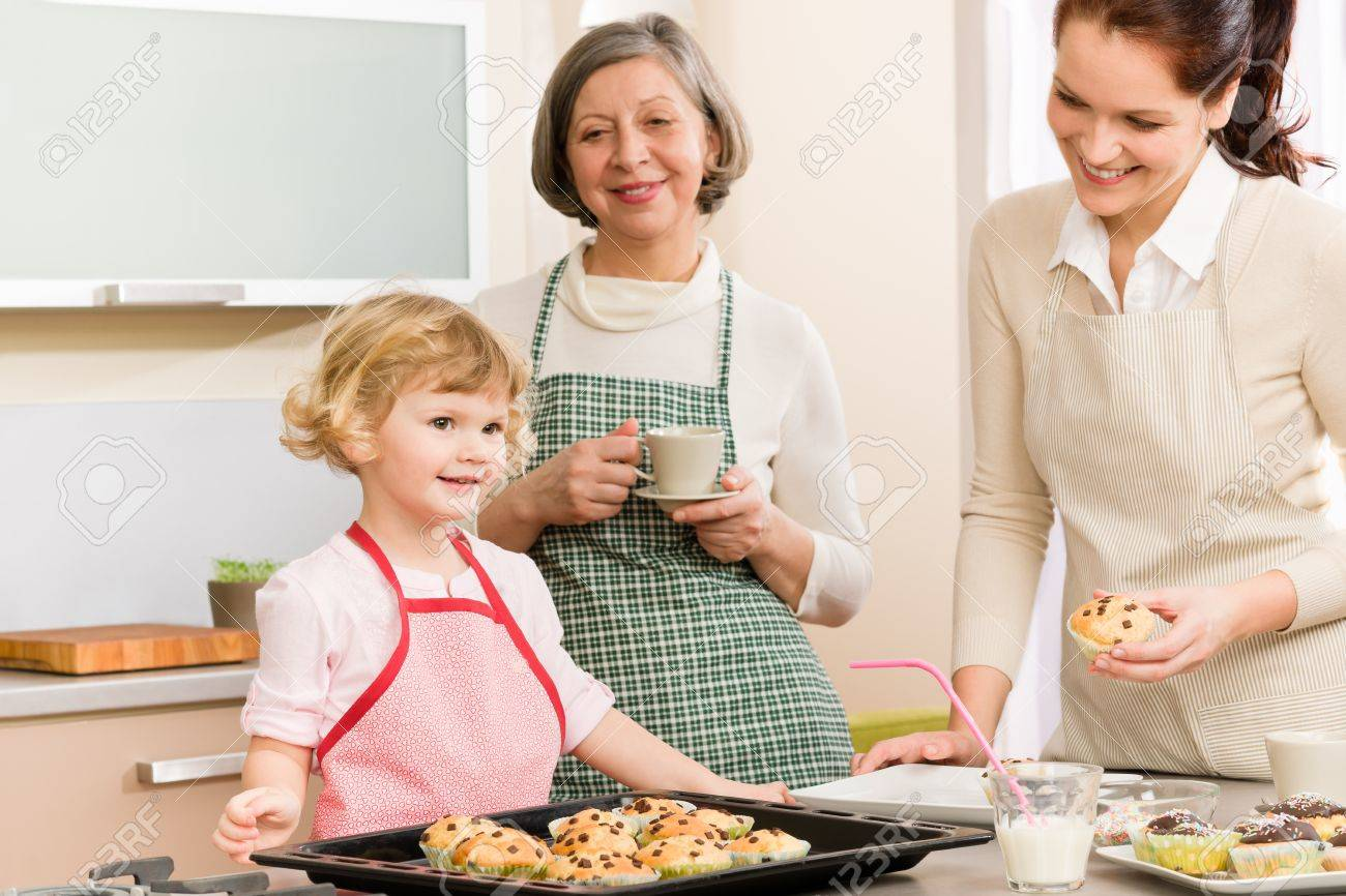 Grandmother, mother and child girl making cupcakes in kitchen Stock Photo - 12756848