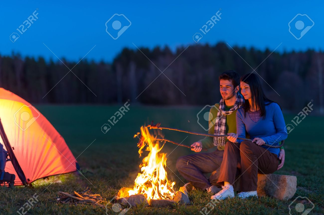 Camping night couple cook by campfire backpack in romantic countryside Stock Photo - 13258679