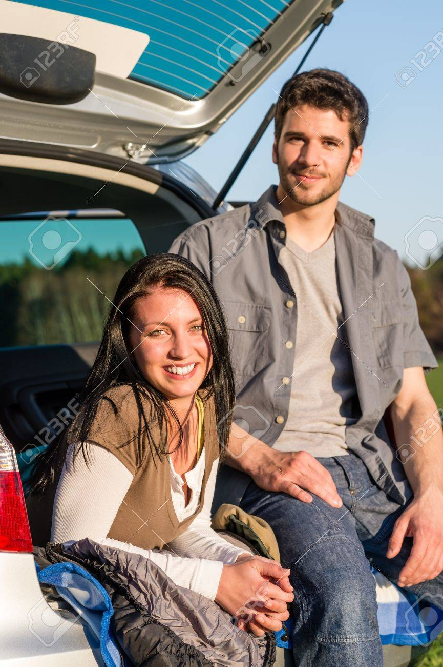 Camping young couple smiling together in car summer sunset Stock Photo - 13258371