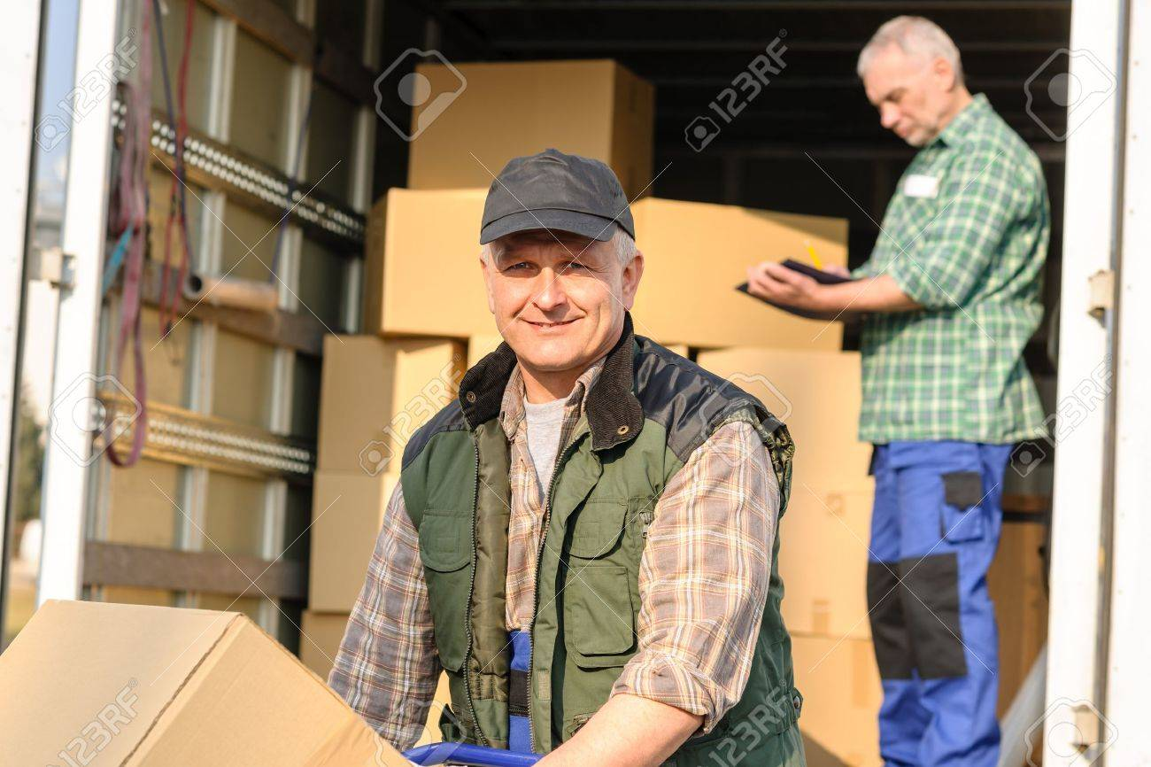 Male mover loading van with cardboard box delivery service Stock Photo - 13355370