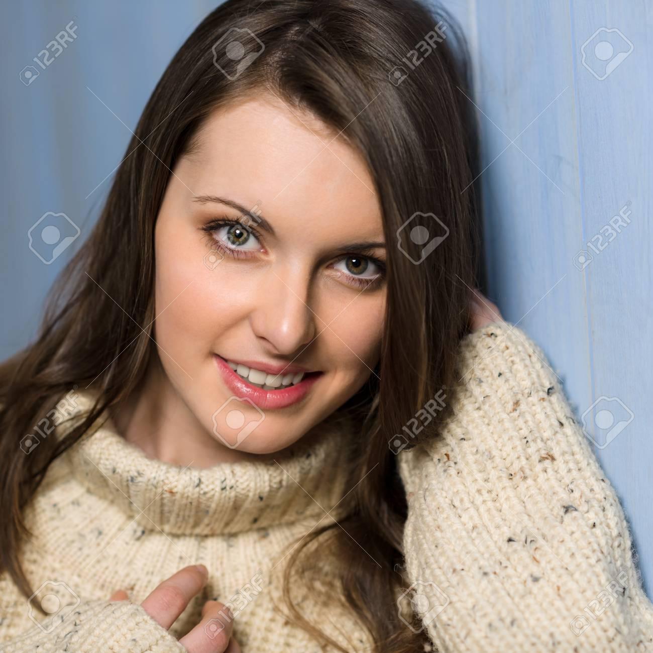 Beautiful smiling winter woman wearing beige sweater portrait Stock Photo - 13556234