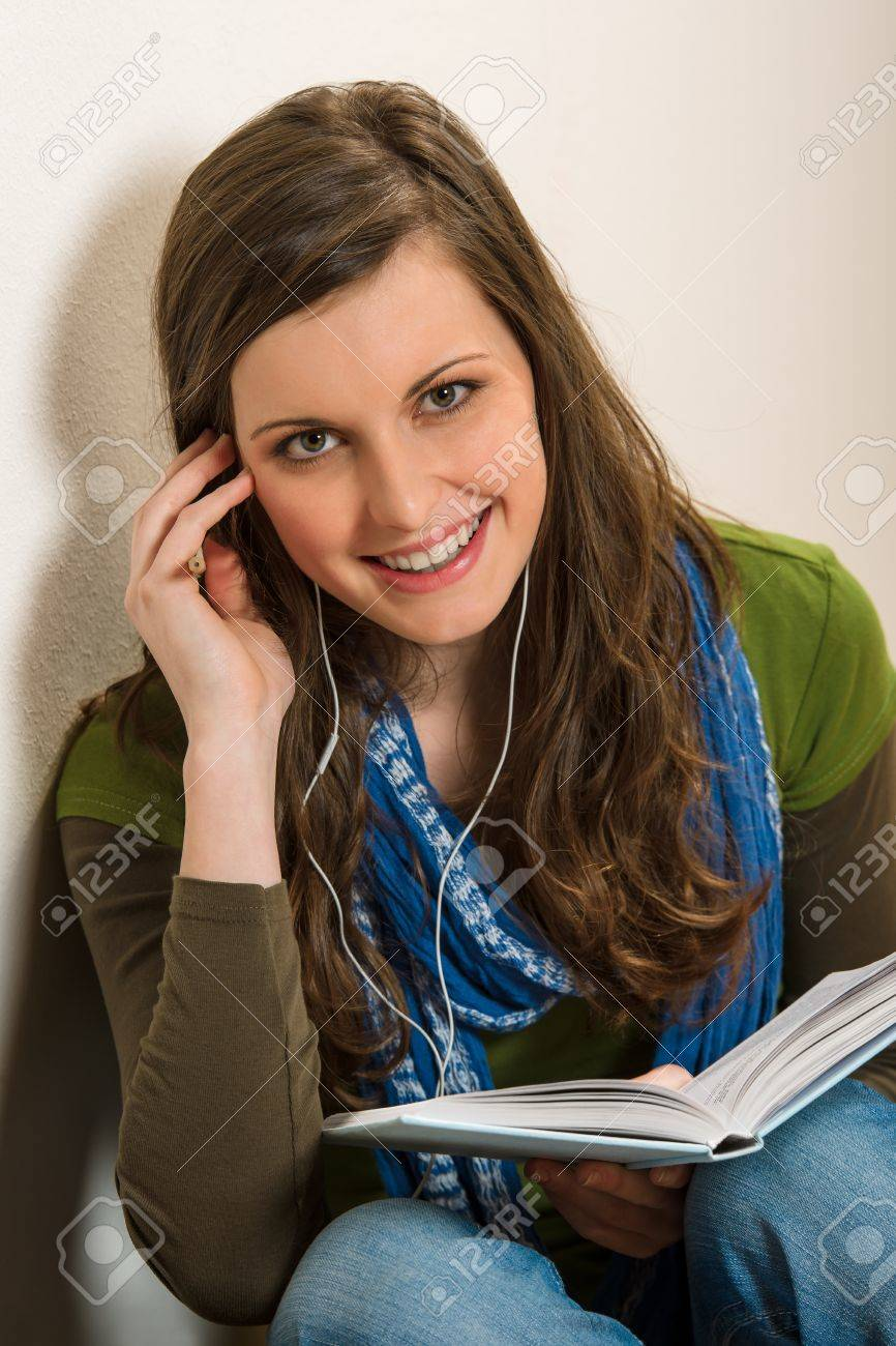 Portrait of student teenager woman with book listen music Stock Photo - 13563745