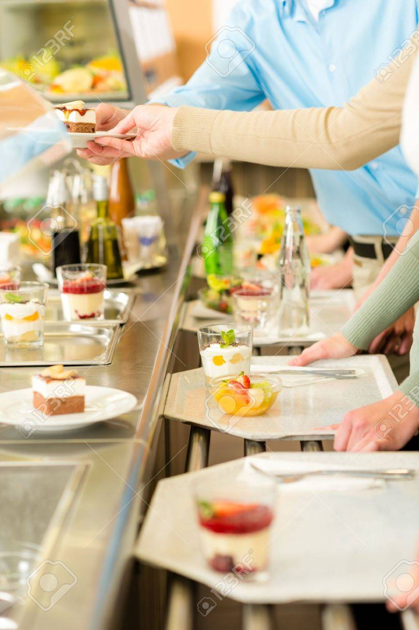 Desserts at cafeteria people with serving tray self service canteen Stock Photo - 13563686