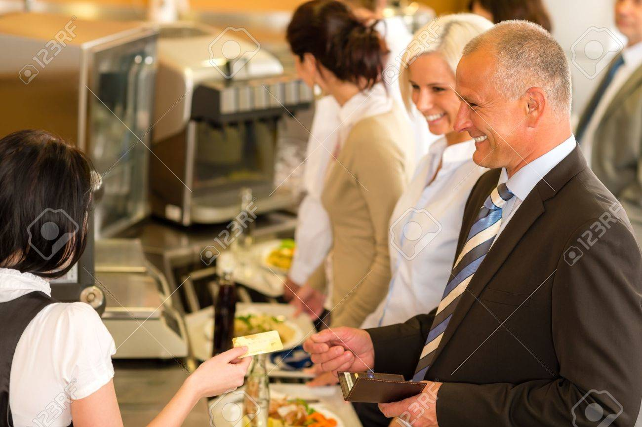 Cafeteria man pay by credit card cashier food on serving tray Stock Photo - 13715861