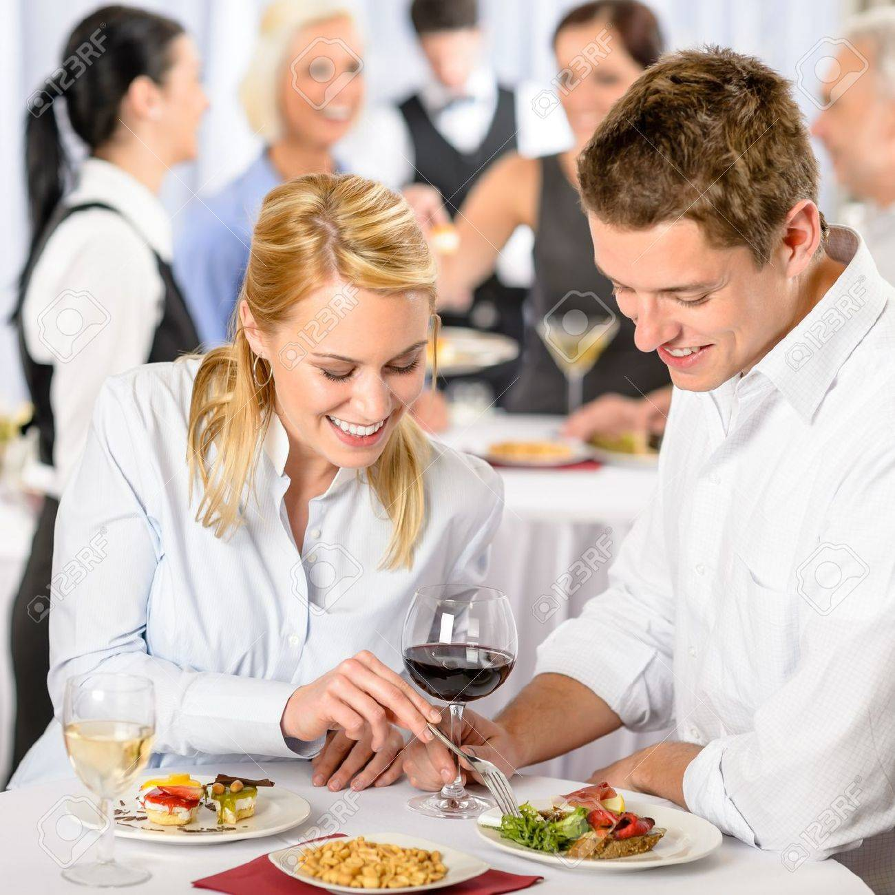 catering company event young colleagues eating at buffet party catering company event young colleagues eating at buffet party stock photo 13736850