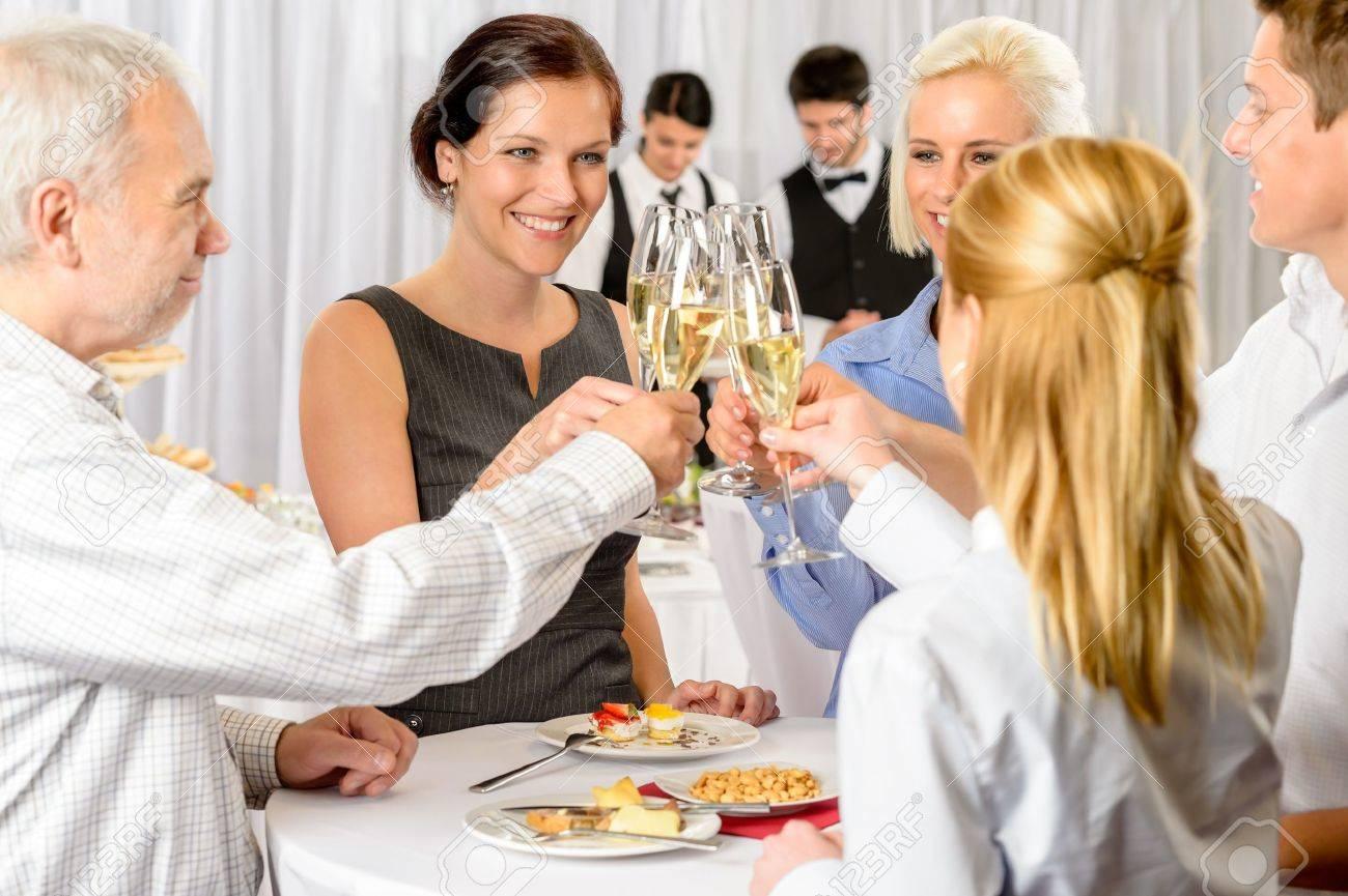 Business partners toast champagne company event celebration success Standard-Bild - 13736859