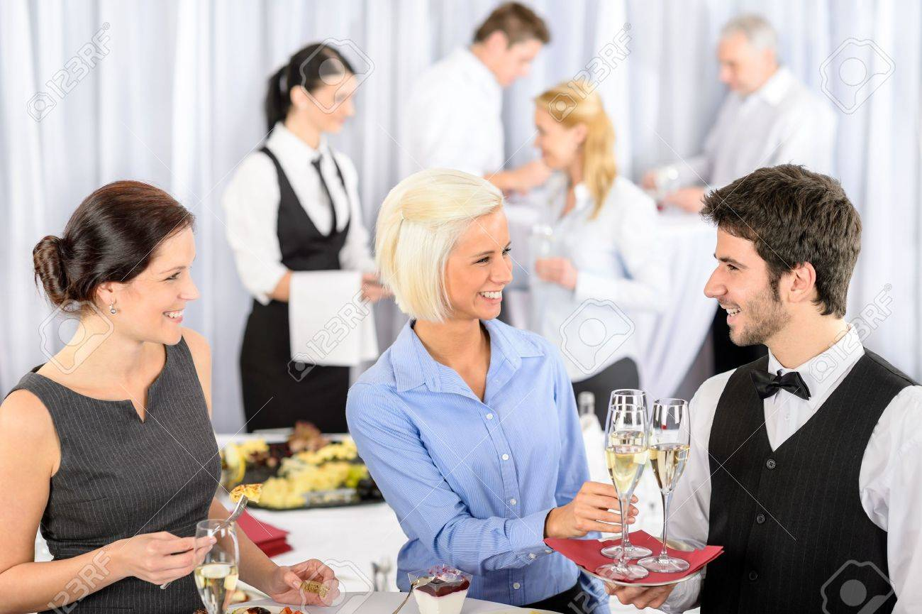 Business woman take aperitif from waiter during company seminar meeting Stock Photo - 13764234