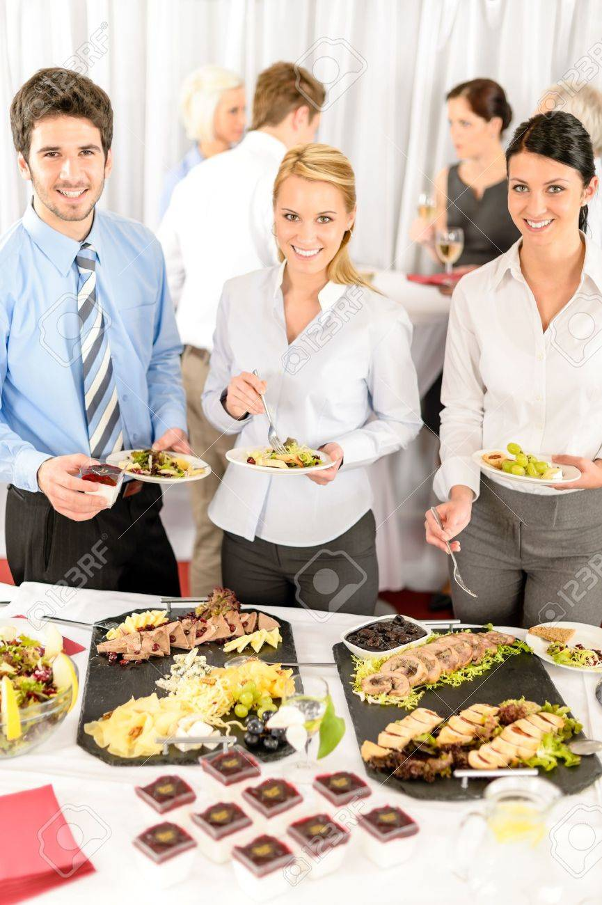 Business Catering People Serving Themselves Buffet At Company ...