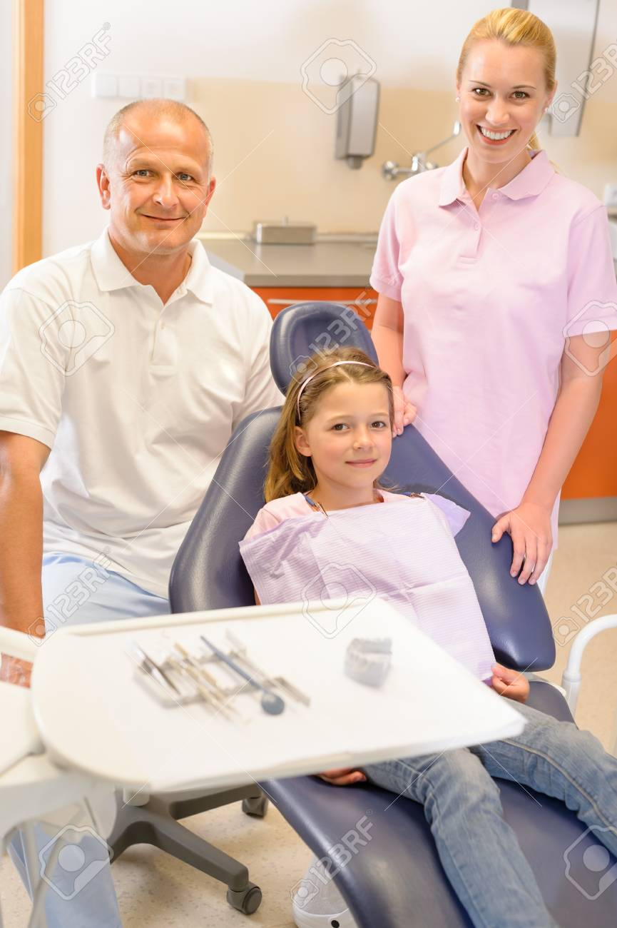 Portrait of dental team with young girl in stomatology clinic Stock Photo - 13867243