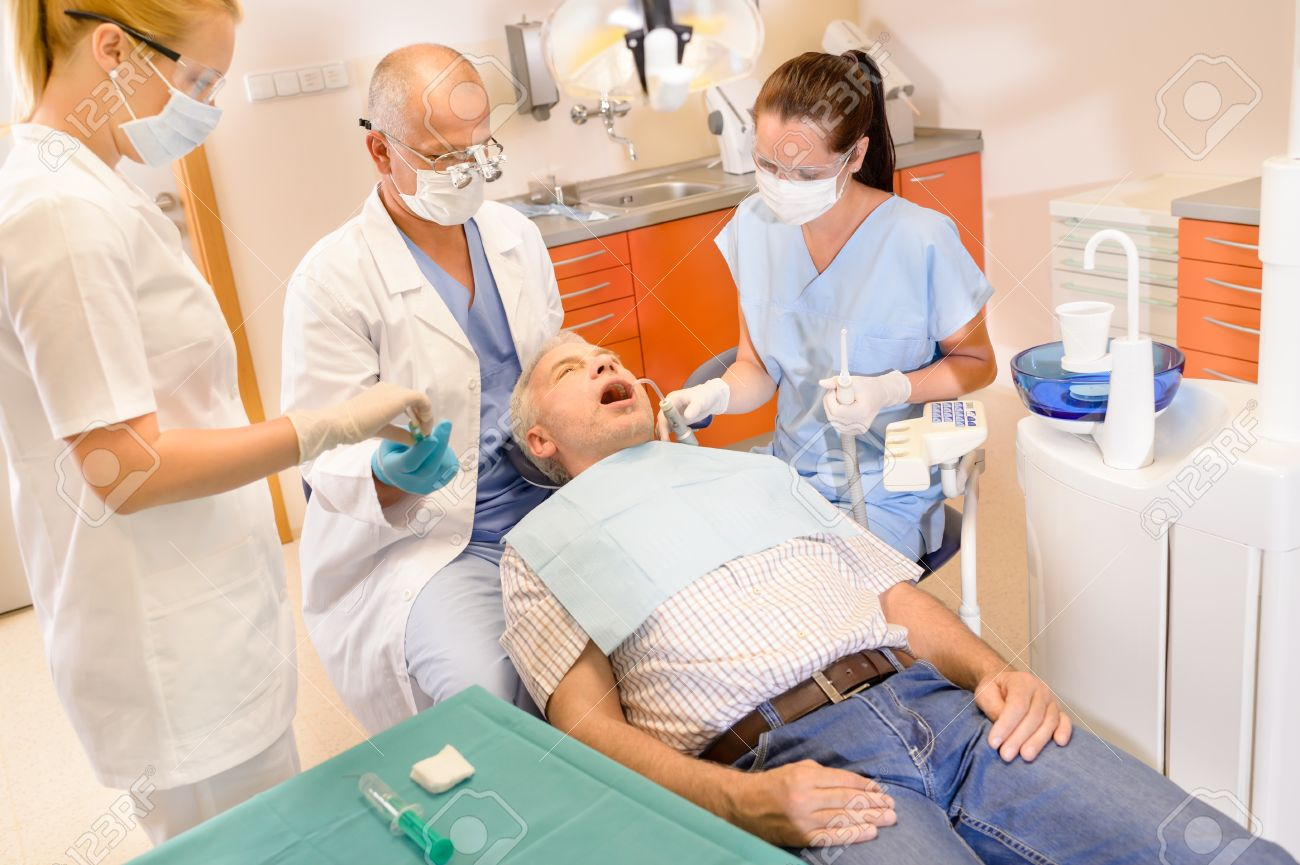 Senior man at dentist surgery having teeth checkup dental assistant Stock Photo - 13922086