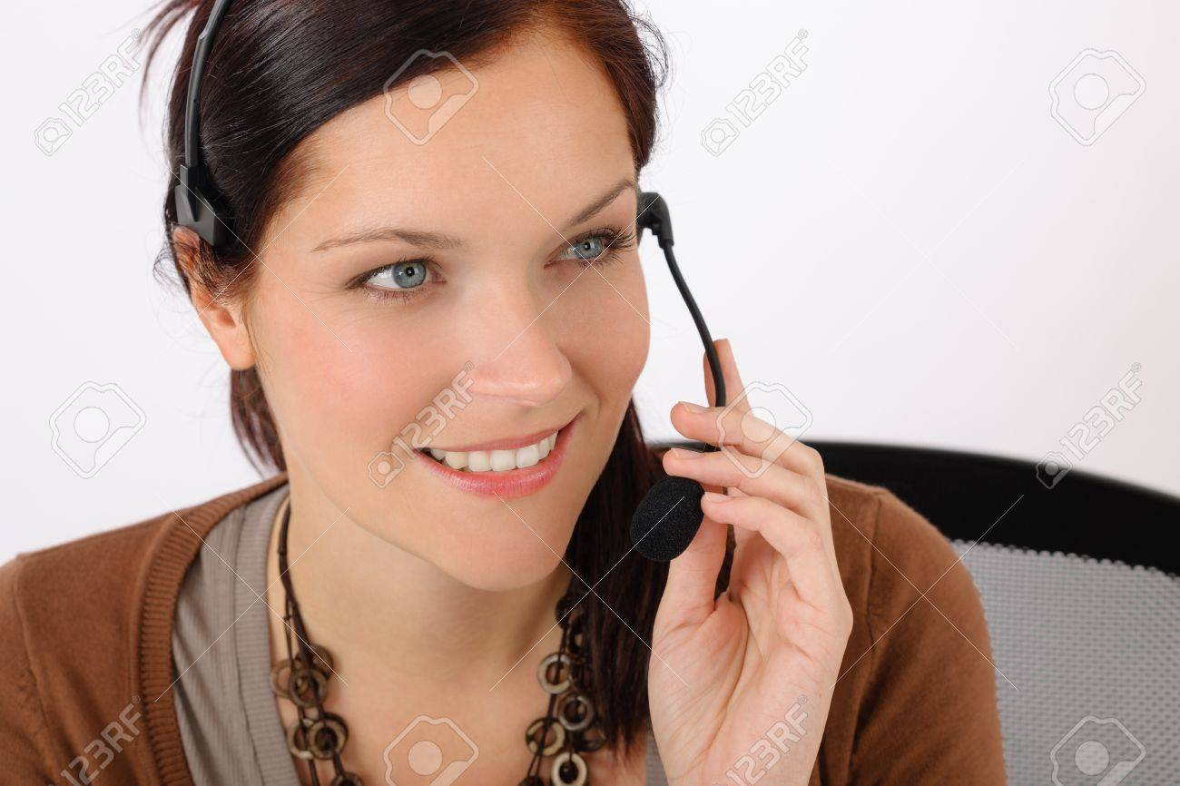Friendly help desk woman smiling call center operator phone headset Stock Photo - 14104165