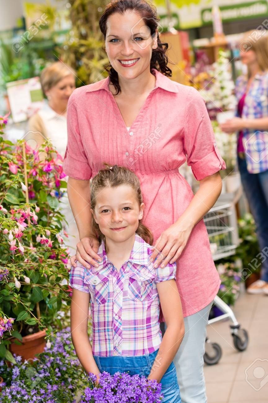 Little girl with her mum shopping at plant market Stock Photo - 14524777