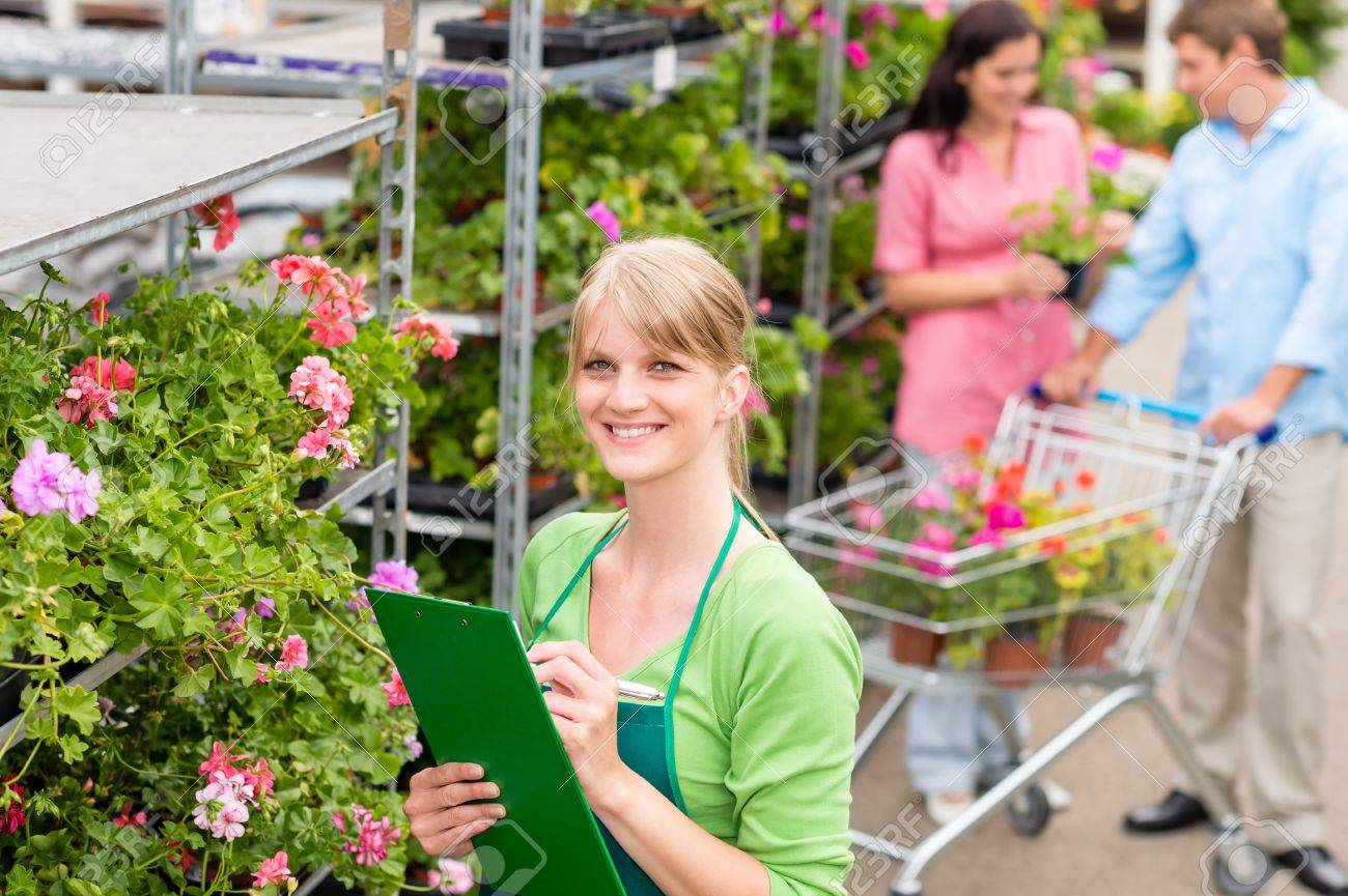 Female florist working at garden centre retail inventory Stock Photo - 14547945