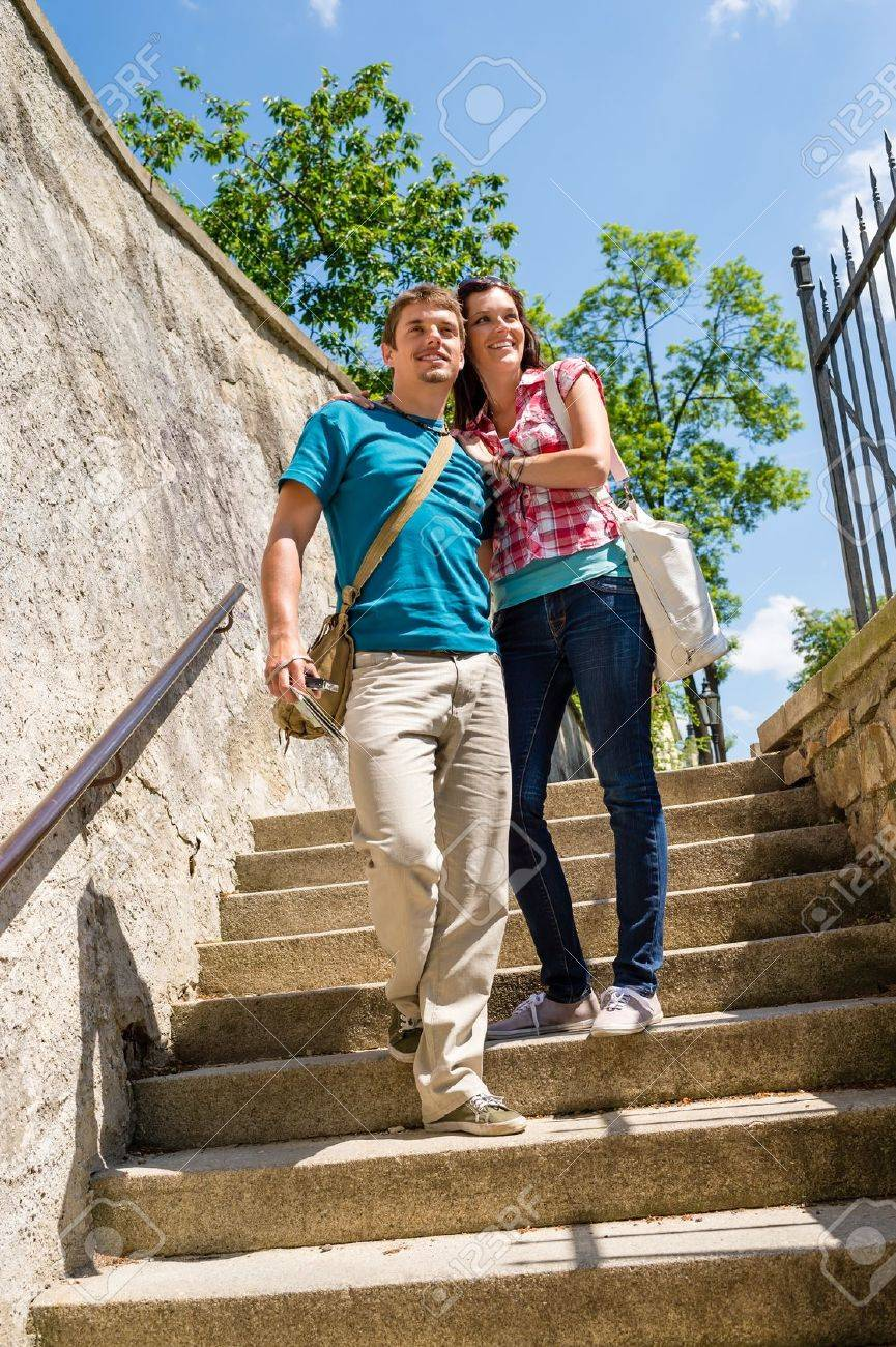 Young happy couple walking down stairs smiling in love Stock Photo - 14735532