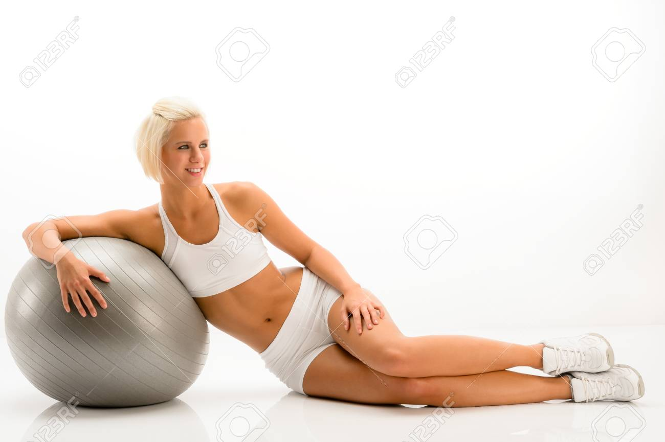 Sportive woman leaning on gym ball on white background Stock Photo - 14961838