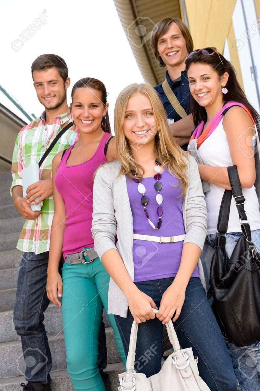 stock photo students back to school on college stairs teens standing smiling