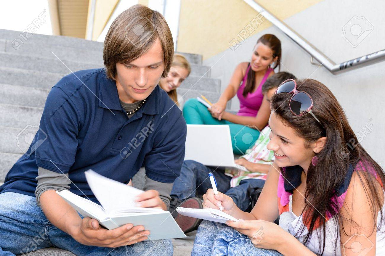 stock photo student helping his colleague with school work steps teens college