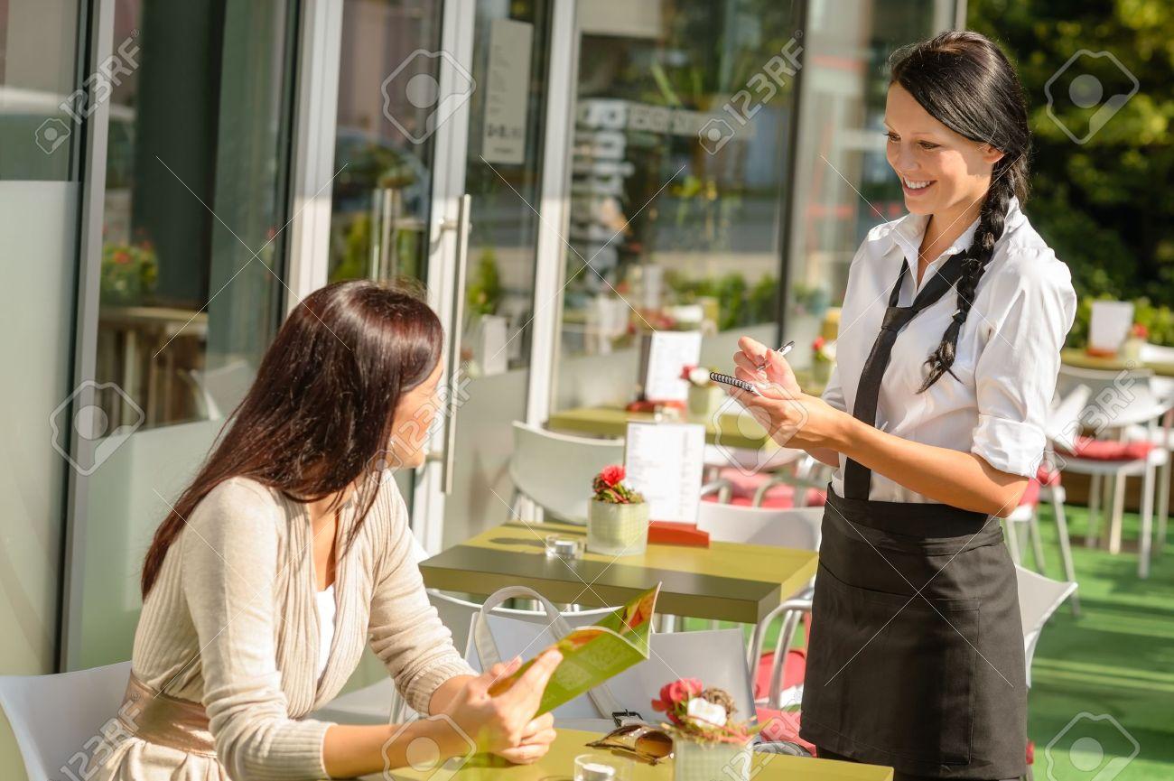 Waitress taking woman Stock Photo - 15154808