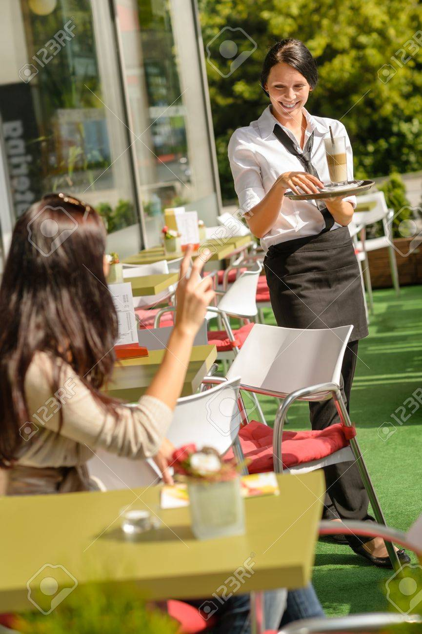 Waitress bringing woman her order coffee cafe restaurant terrace Stock Photo - 15154807