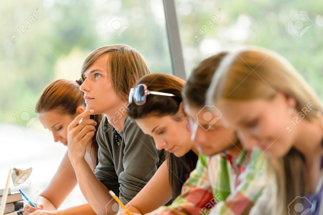high-school student thinking at exam class teens writing college